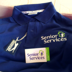 senior services polo shirt